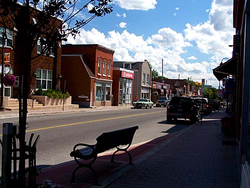 Downtown Acton, Mill St, with the park bench by the road