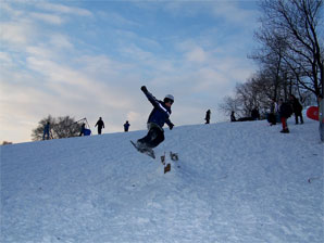Snowboarders in Acton park