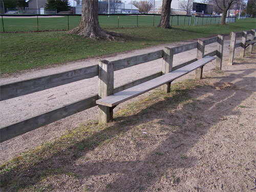 The bench and fence at one of Acton's Prospect Park beaches on Fairy Lake.