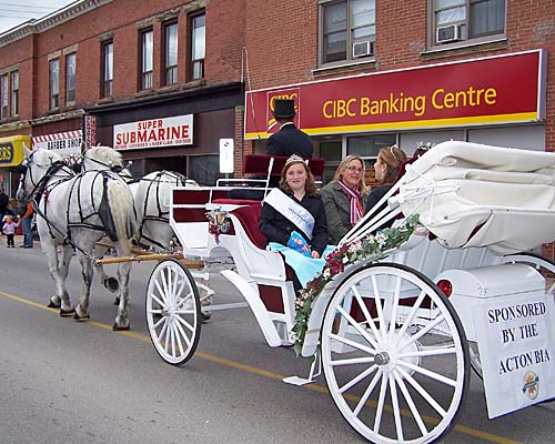 2007 Acton Ontario Fall Fair. The Miss Acton winners and Erin Hamilton, Leathertown Ambassador, drive in a horse drawn carriage during the fair parade