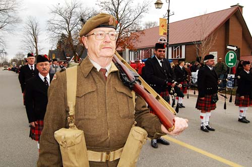 Acton Remembrance Day Parade. Soldier in second world war uniform with rifle